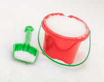 The red green bucket and shovel Royalty Free Stock Images