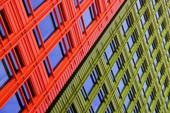 Red and green buildings contrast next to each other Royalty Free Stock Photo