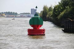 Red green buoy in the waterway marking that both sides can be used in river Noord in The Netherland. S stock photos