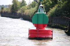 Red green buoy in the waterway marking that both sides can be used in river Noord in The Netherland. S stock photo
