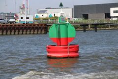 Red green buoy in the waterway marking that both sides can be used in river Noord in The Netherland. S stock images