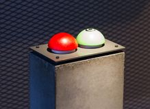 Red and green button. On a concrete pillar Stock Image