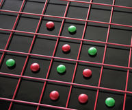 Red, green candies in a grid Royalty Free Stock Photos