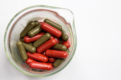 Red and green capsules Stock Image