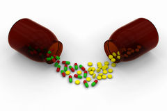 Red green capsules Vs yellow pills Royalty Free Stock Images