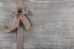 Red green checked ribbon on wooden background for christmas or o Stock Photo