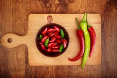 Red and green chile peppers stock image