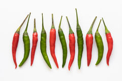 Red and green chili pepper. On a white background Royalty Free Stock Photo