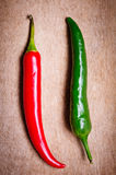 Red and green chili peppers. On a wooden background Stock Photography