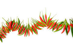 Red and green chili peppers. Isolated on the white Royalty Free Stock Images