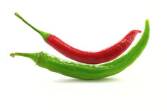 Red and green chili peppers. On white background Stock Photography