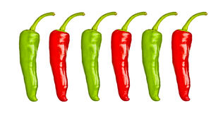 Red and green chili peppers isolated on white. Red and green chili peppers isolated on a white background Royalty Free Stock Photography