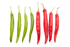 Red and green chili peppers. Isolated on the white background Royalty Free Stock Photos