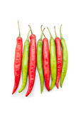 Red and green chili peppers. Isolated on the white background Royalty Free Stock Images