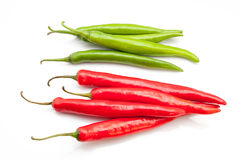 Red and green chili peppers. Isolated on the white background Stock Photography