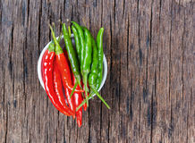 Red and green chili peppers. Stock Image