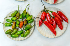 Red and Green Chili Peppers. For Sale at the Market Royalty Free Stock Photography