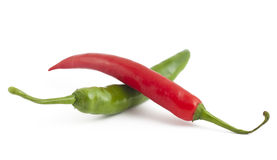 Red and green chili peppers on white. Background Stock Photos