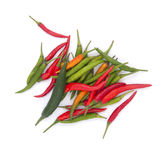 Red and green chili peppers on a white background. Royalty Free Stock Images