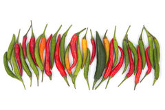 Red and green chili peppers on a white background. Stock Photo