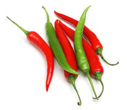 Red & Green Chilli Peppers Isolated. Red and green chilli peppers on white background Royalty Free Stock Photo