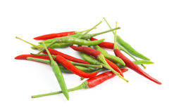 Red and green chilli peppers  on white. The spicy taste Stock Photography