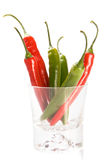 Red and green  chilly peppers in glass Stock Photos