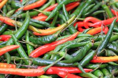 Red and green chilly texture. As nice food background Stock Photo