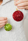 Red and green Christmas baubles Royalty Free Stock Images