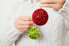 Red and green Christmas baubles Stock Photo