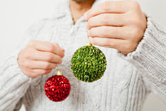 Red and green Christmas baubles Stock Image