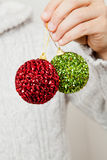 Red and green Christmas baubles Stock Photos