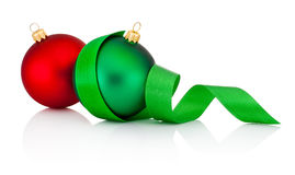 Red and green Christmas baubles with ribbon isolated on white Royalty Free Stock Photo