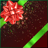 Red and green Christmas Bow with confetti on gift box Stock Photos
