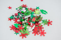 Red And Green Christmas Craft Embellishments. Various christmas craft embellishments isolated on white. Snowflakes, stars, bells, leaves and more. Shiny Royalty Free Stock Photography