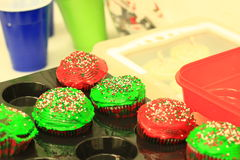 Red and Green Christmas Cupcakes. Christmas Cupcakes with red and green frosting Royalty Free Stock Photos
