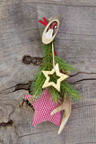 Red and green christmas decoration with antler and stars on wood Royalty Free Stock Photography