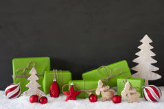 Red And Green Christmas Decoration, Black Cement Wall, Snow Royalty Free Stock Photography