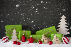Red And Green Christmas Decoration, Black Cement Wall, Snow, Snowflakes Royalty Free Stock Image