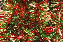 Red and Green Christmas Garland. Red and Green Christmas Tinsel for Wallpaper or Background stock photography