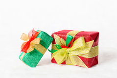 Red and green Christmas gift box with shiny golden ribbon Stock Images