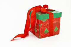 Red and green Christmas gift with ribbon isolated Royalty Free Stock Photos