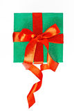 Red and green Christmas gift with ribbon isolated Royalty Free Stock Image