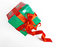 Red and green Christmas gift with ribbon isolated Stock Image
