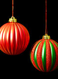 Red and Green Christmas ornaments on black Stock Image