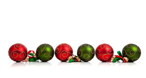 Red and Green Christmas ornaments with ribbon Stock Photos