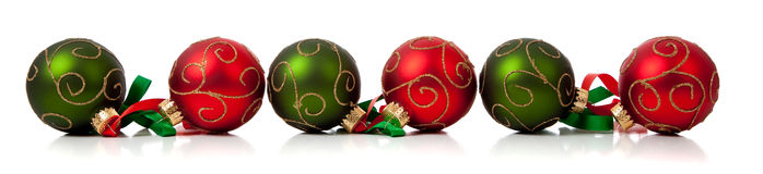 Red and Green Christmas ornaments with ribbon Royalty Free Stock Images