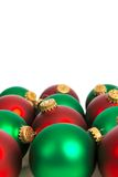 Red and green Christmas ornaments on white Royalty Free Stock Photos