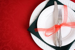 Red and green christmas place settings Stock Images