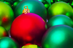 Red and green Christmas tree baubles stock photo